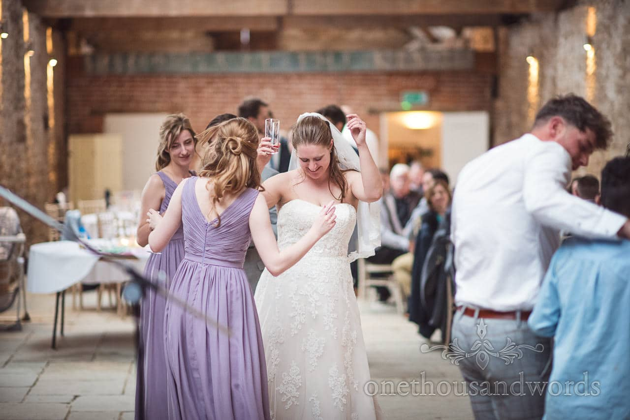 Bride and bridesmaids on dance floor during Tithe Barn Symondsbury Wedding