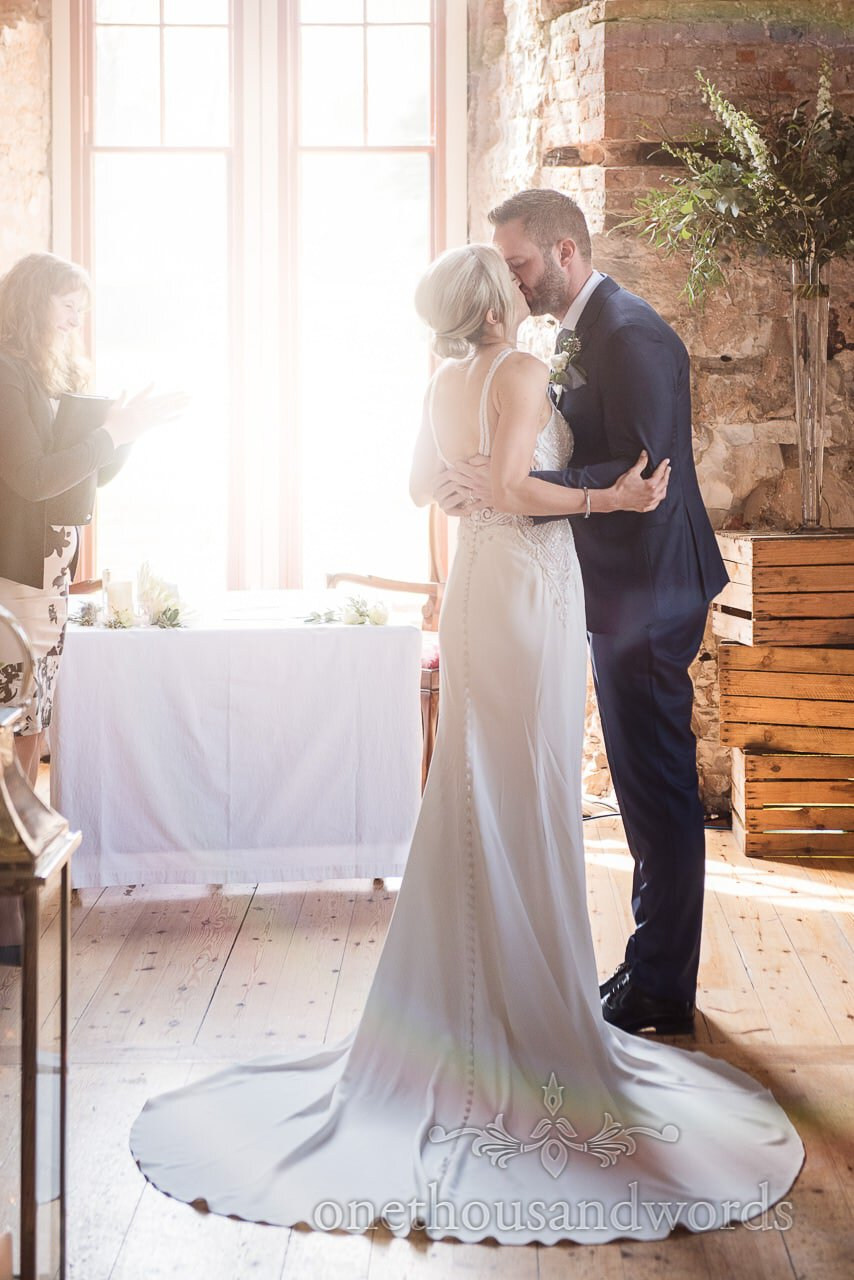 Bride and groom first kiss at Lulworth Castle Wedding Photos by one thousand words