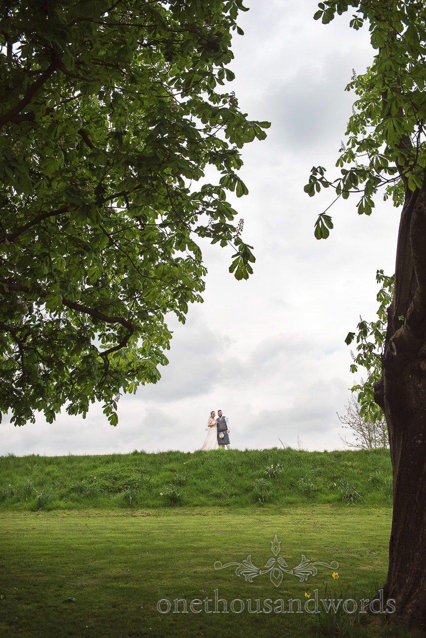 Bride and groom in garden at Tithe Barn Symondsbury Wedding