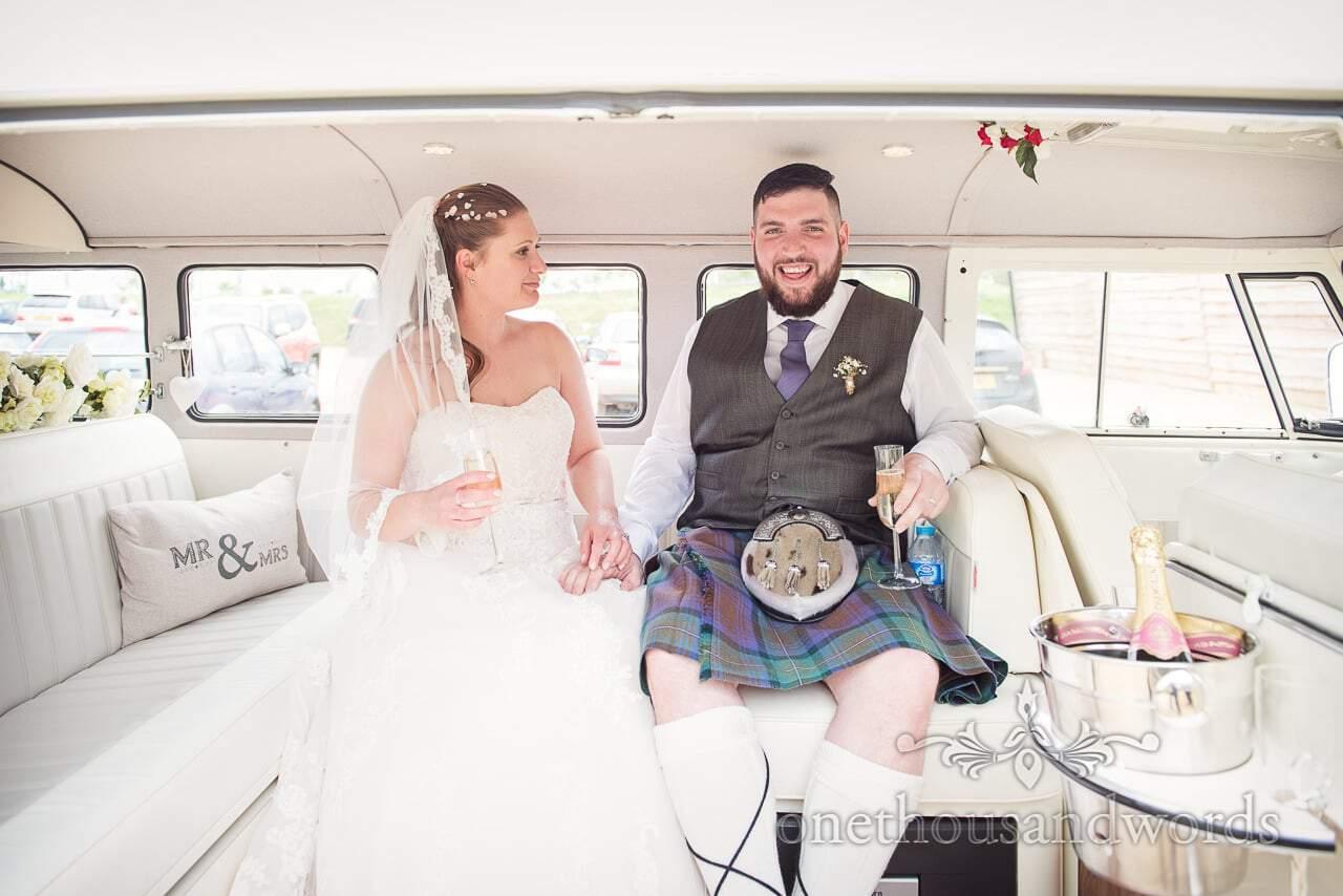 Bride and groom in Volkswagen bus from Tithe Barn Symondsbury Wedding