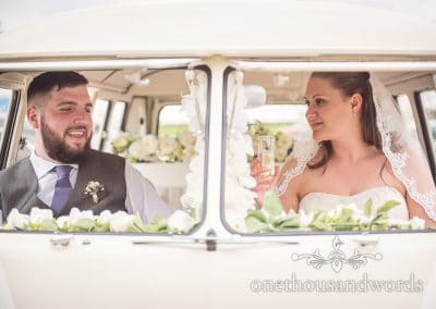 Bride and groom in VW bus during Tithe Barn Symondsbury Wedding