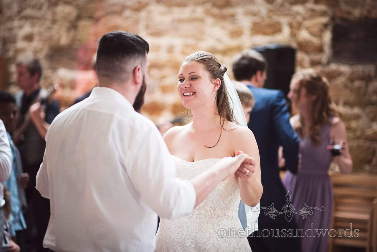 Bride and groom on dance floor during Tithe Barn Symondsbury Wedding