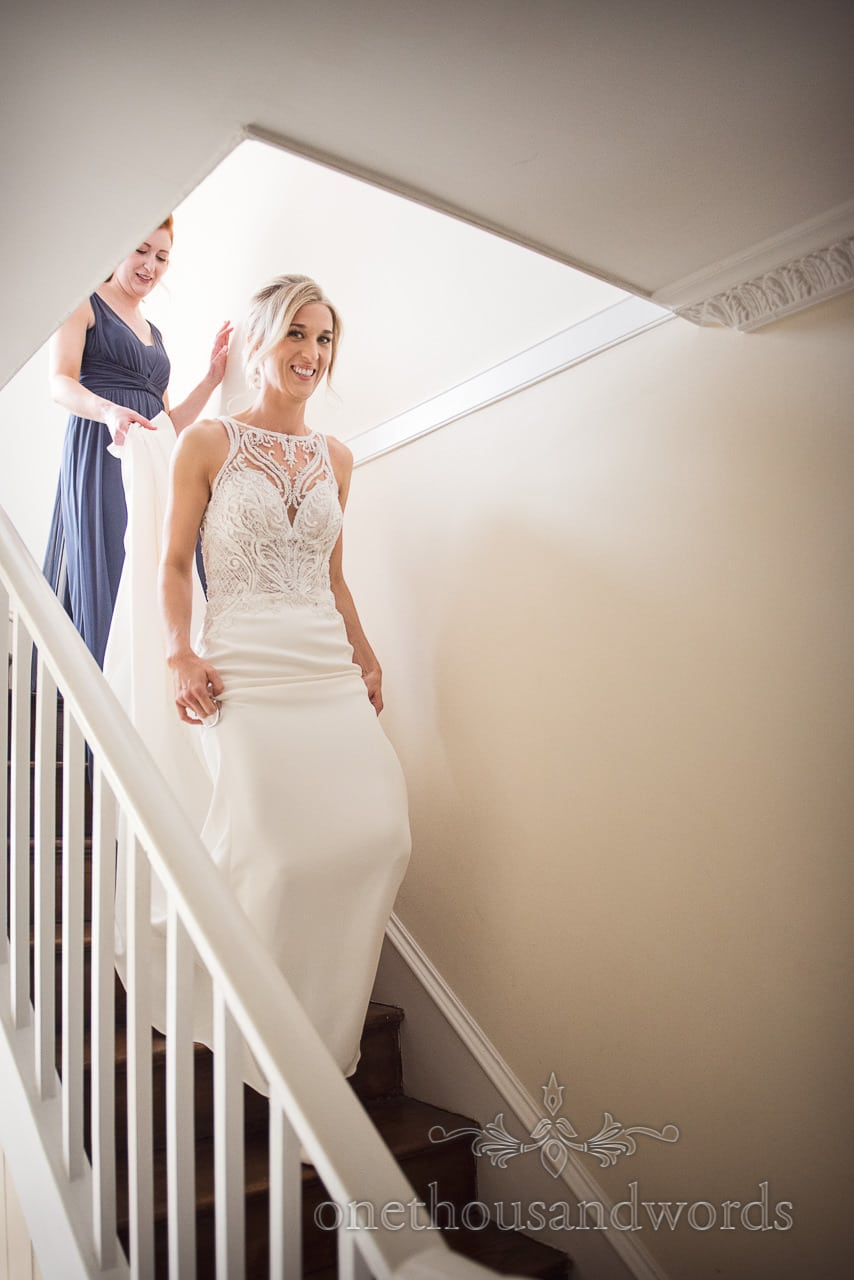 Bride ascends stairs before Lulworth Castle Wedding Photos