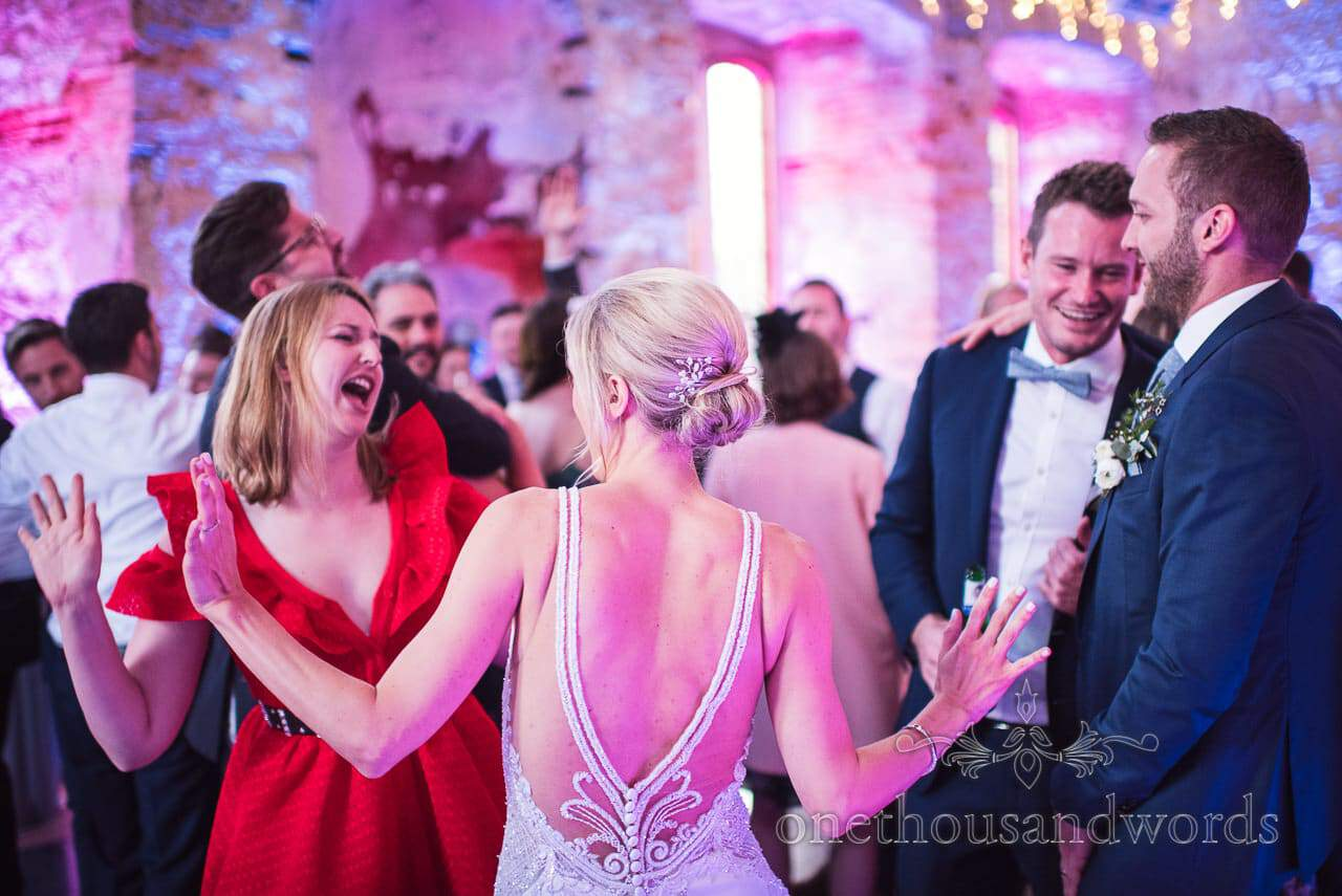 Bride dancing at Lulworth Castle Wedding Photos by one thousand words