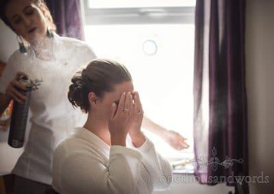 Bride has hair styled from Tithe Barn Symondsbury Wedding