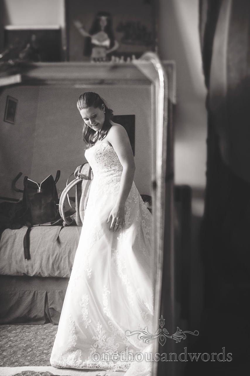 Bride in mirror on morning of Tithe Barn Symondsbury Wedding