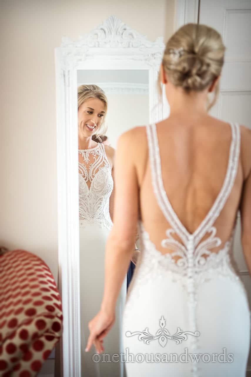 Bride in wedding dress on morning of Lulworth Castle Wedding Photos