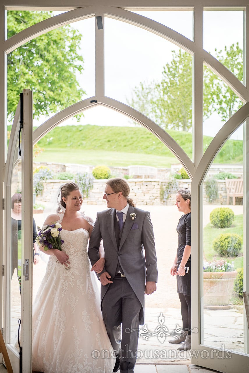 Bride is escorted by brother at Tithe Barn Symondsbury Wedding