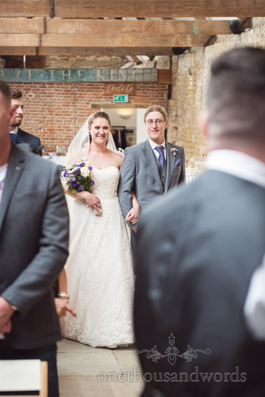 Bride is walked down the aisle by brother at Tithe Barn Symondsbury Wedding