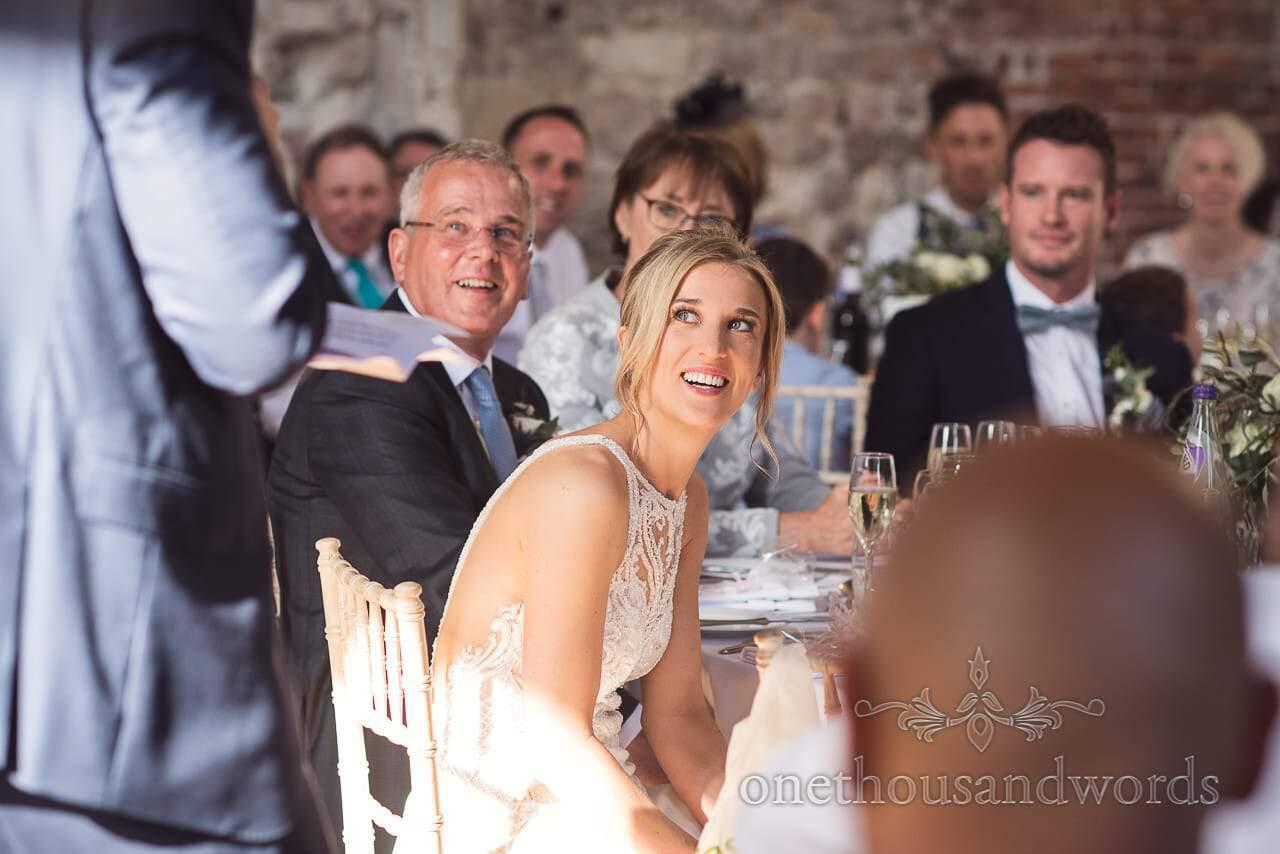 Bride laughs at wedding speeches at Lulworth Castle Wedding venue in Dorset