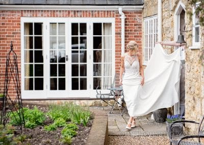 Bride leave house for wedding transport from Lulworth Castle Wedding Photos