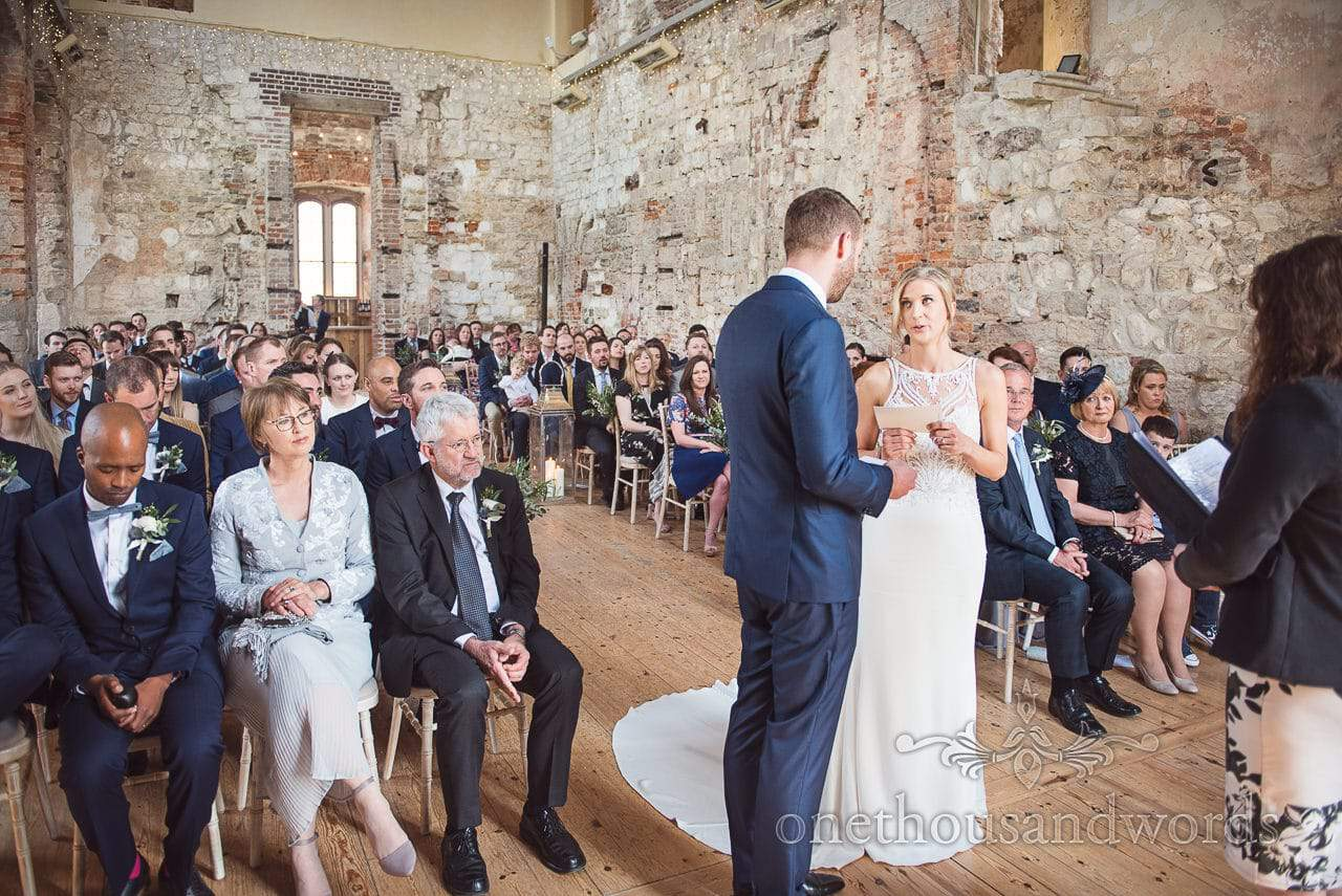 Bride reads heart felt wedding vows to groom at Lulworth Castle Wedding ceremony