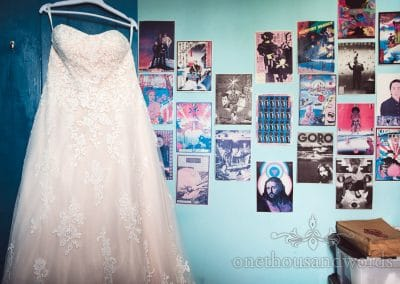 Brides dress hang in childhood bedroom from Tithe Barn Symondsbury Wedding