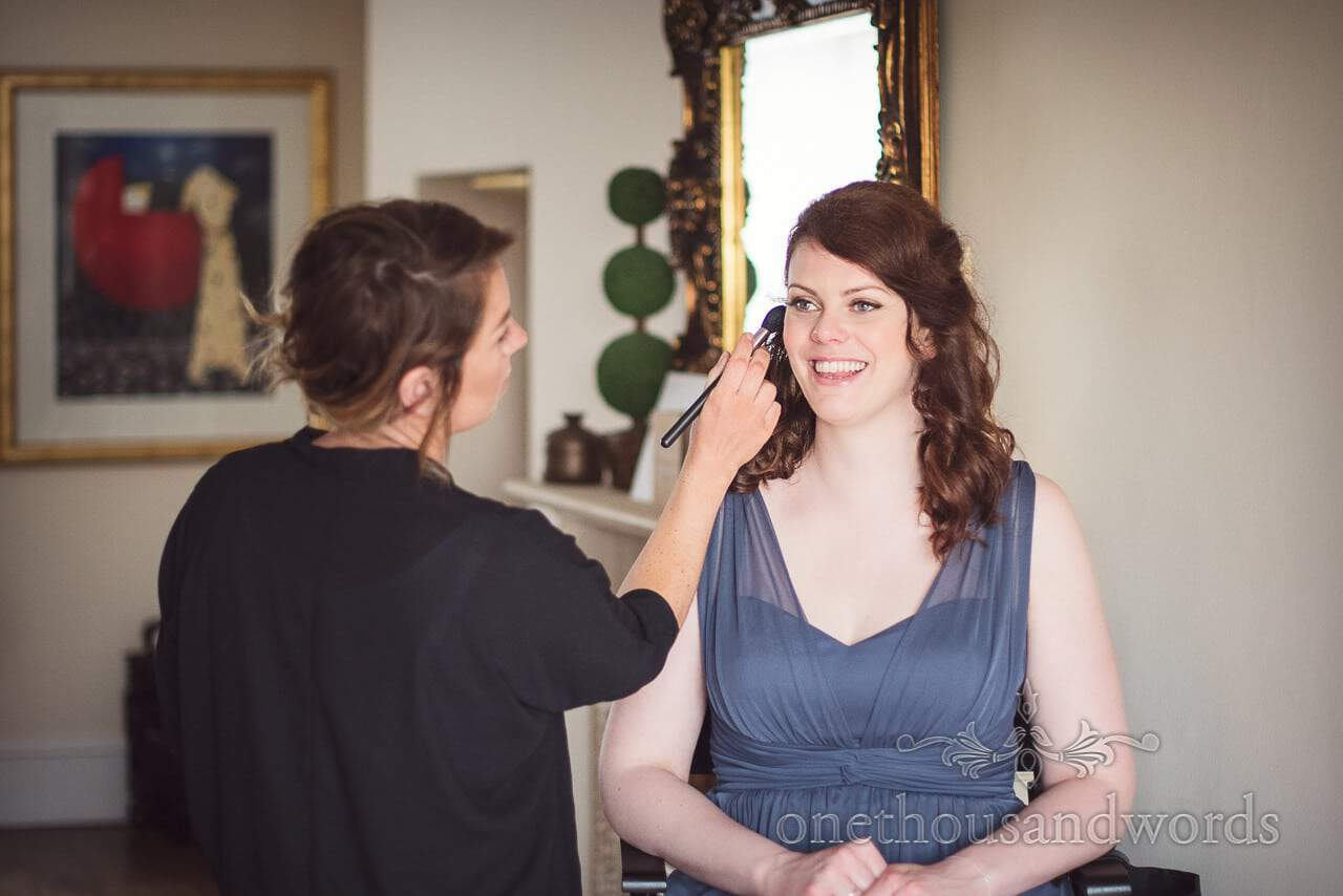 Bridesmaid had make up styled during morning of Lulworth Castle Wedding Photos