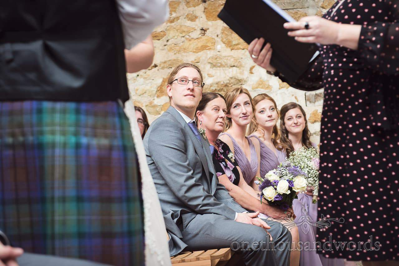 Bridesmaids, mother and brother during ceremony at Tithe Barn Symondsbury Wedding