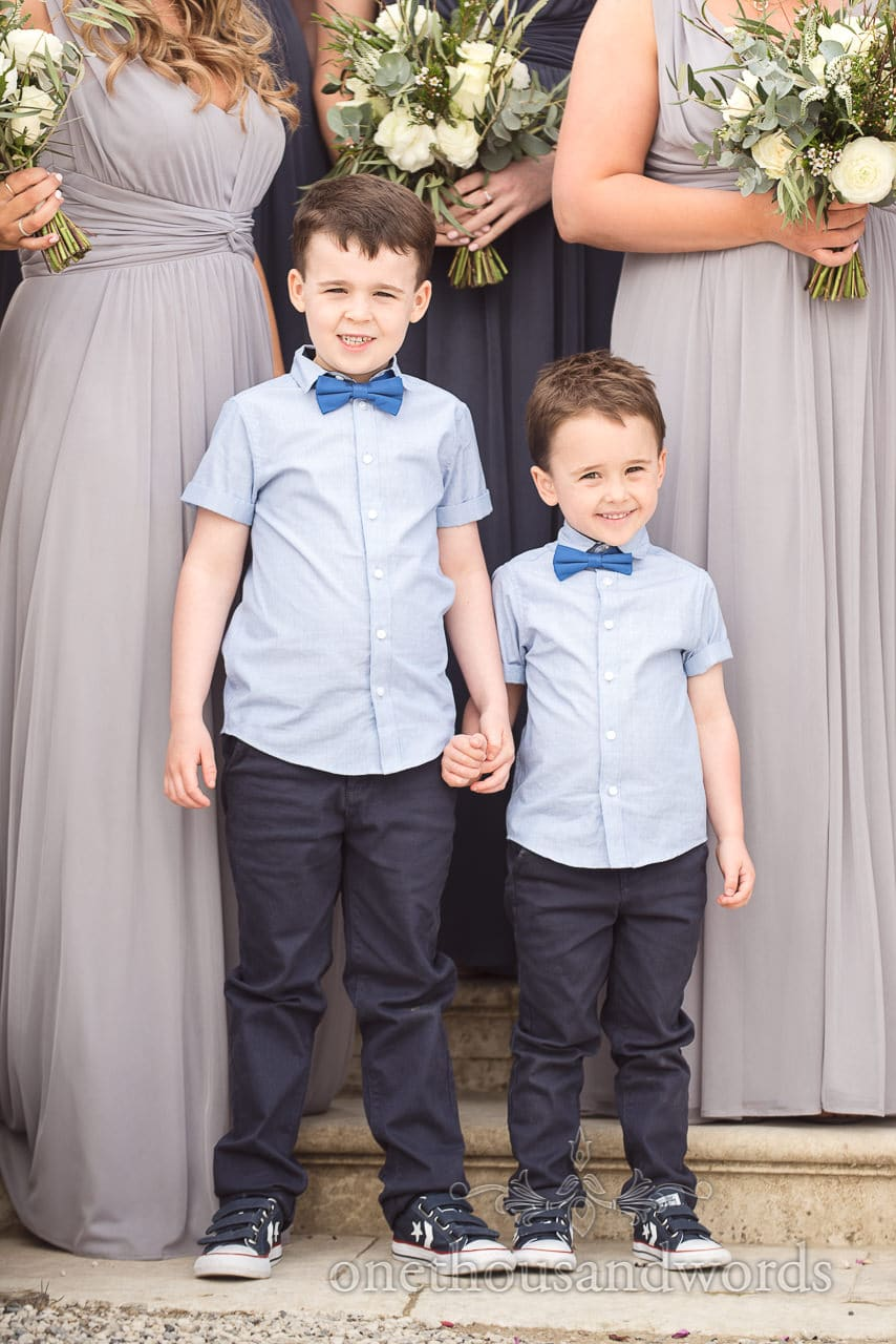 Cute Page boys in blue bow ties group photographs at Lulworth Castle Wedding