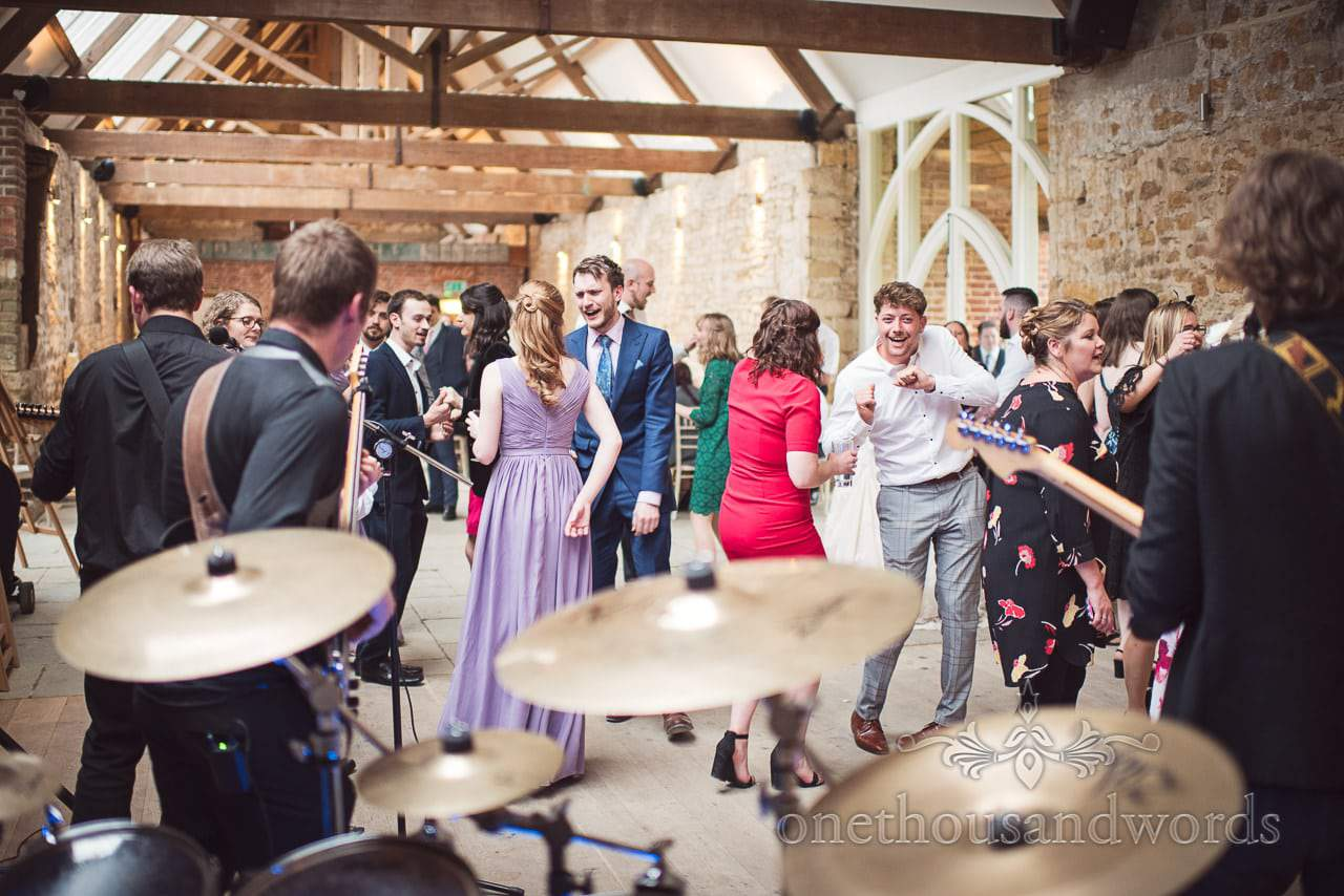Dancing guests from behind the drums at Tithe Barn Symondsbury Wedding