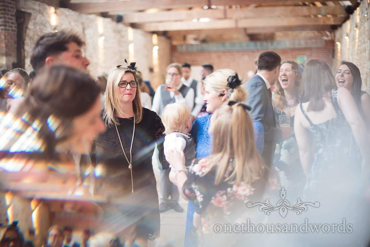 Dancing smiling guests at evening reception during Tithe Barn Symondsbury Wedding
