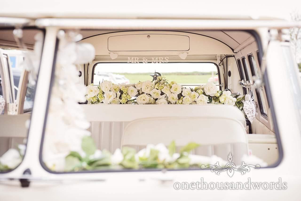Decorated Volkswagen wedding bus from Tithe Barn Symondsbury Wedding