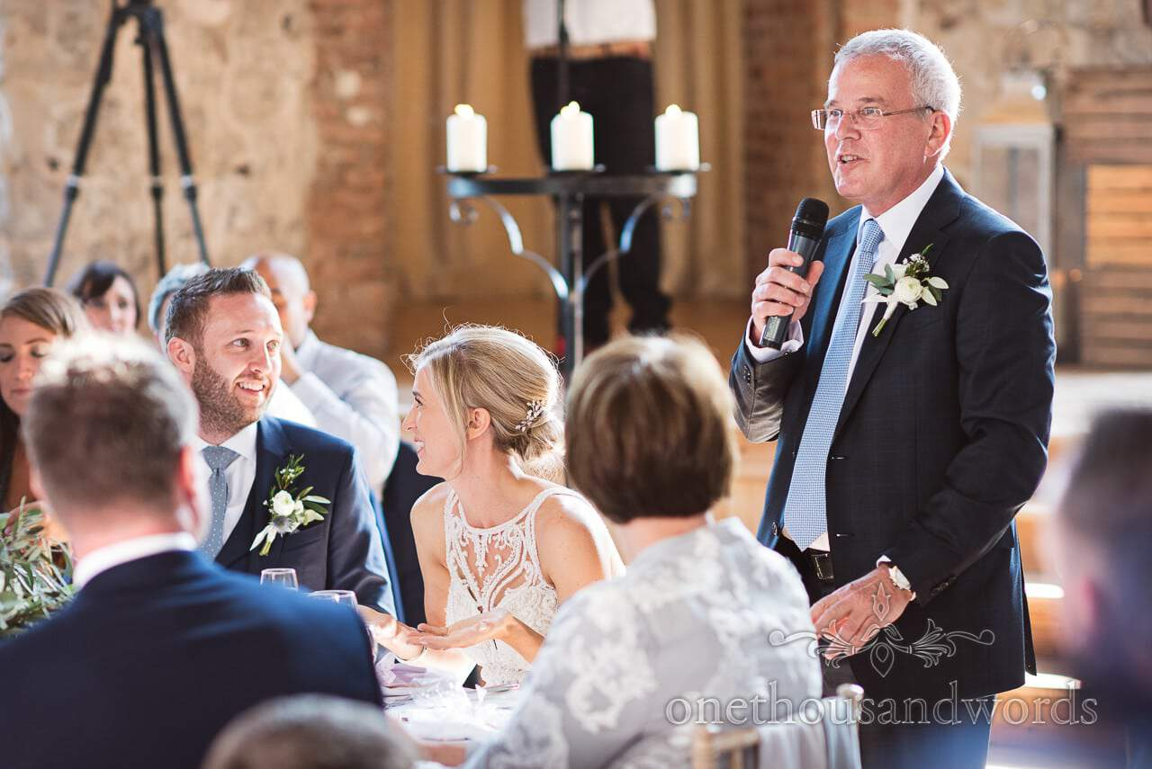 Father of the bride makes wedding speech at Lulworth Castle Wedding