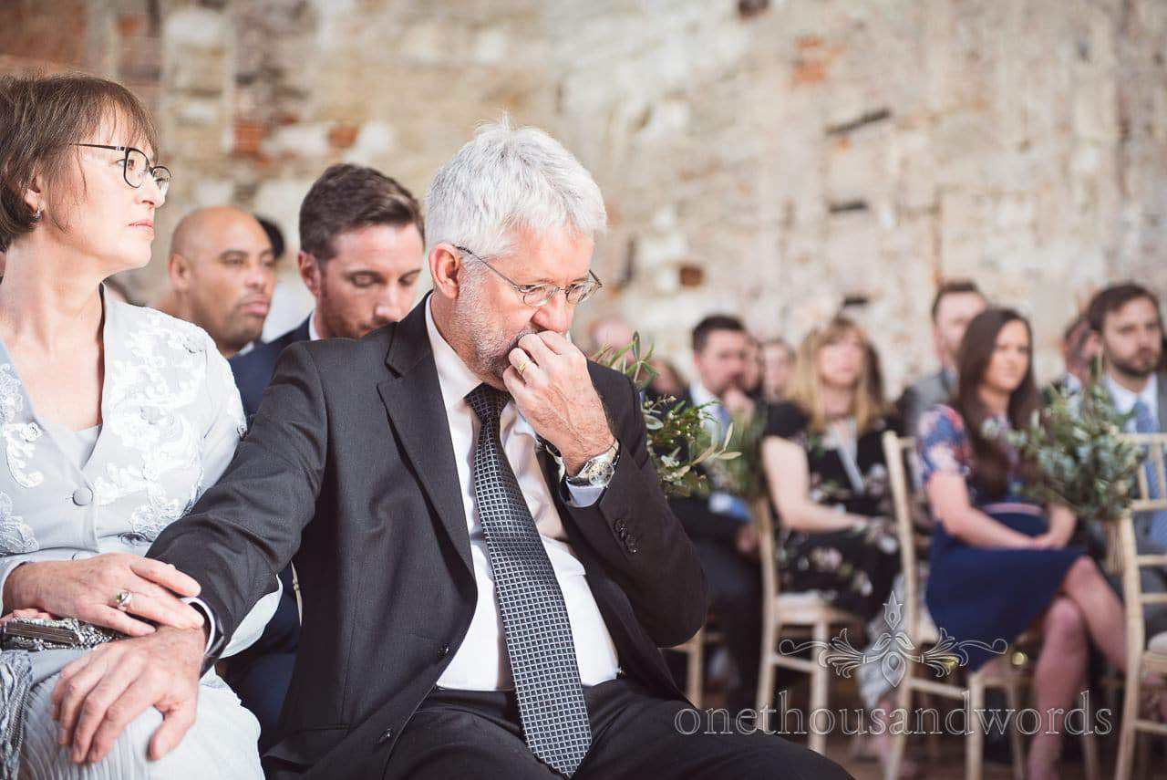 Father of the groom emotional during Lulworth Castle Wedding ceremony
