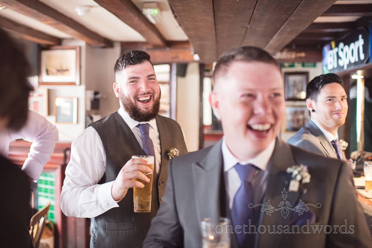 Groom and groomsmen have a drink before Tithe Barn Symondsbury Wedding