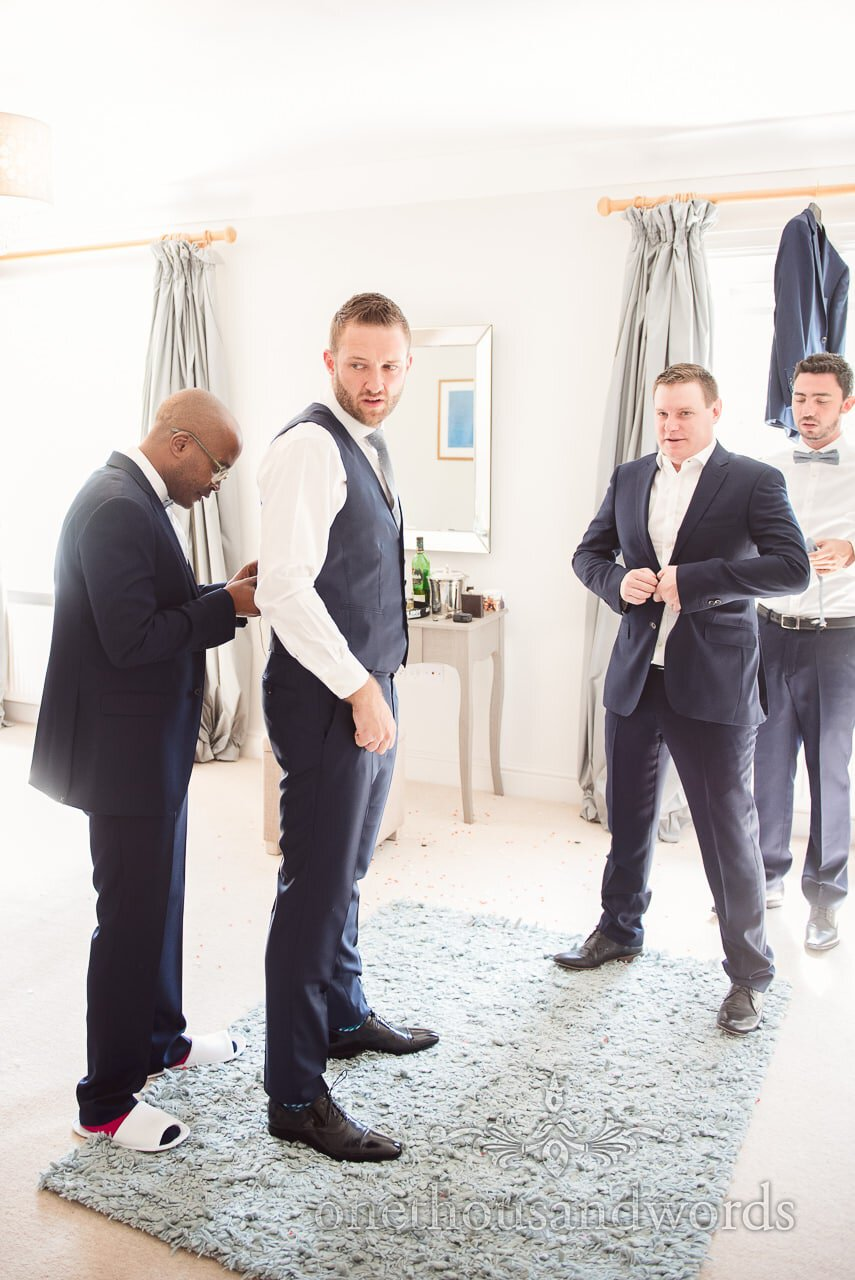 Groom and groomsmen preparation from Lulworth Castle Wedding Photos