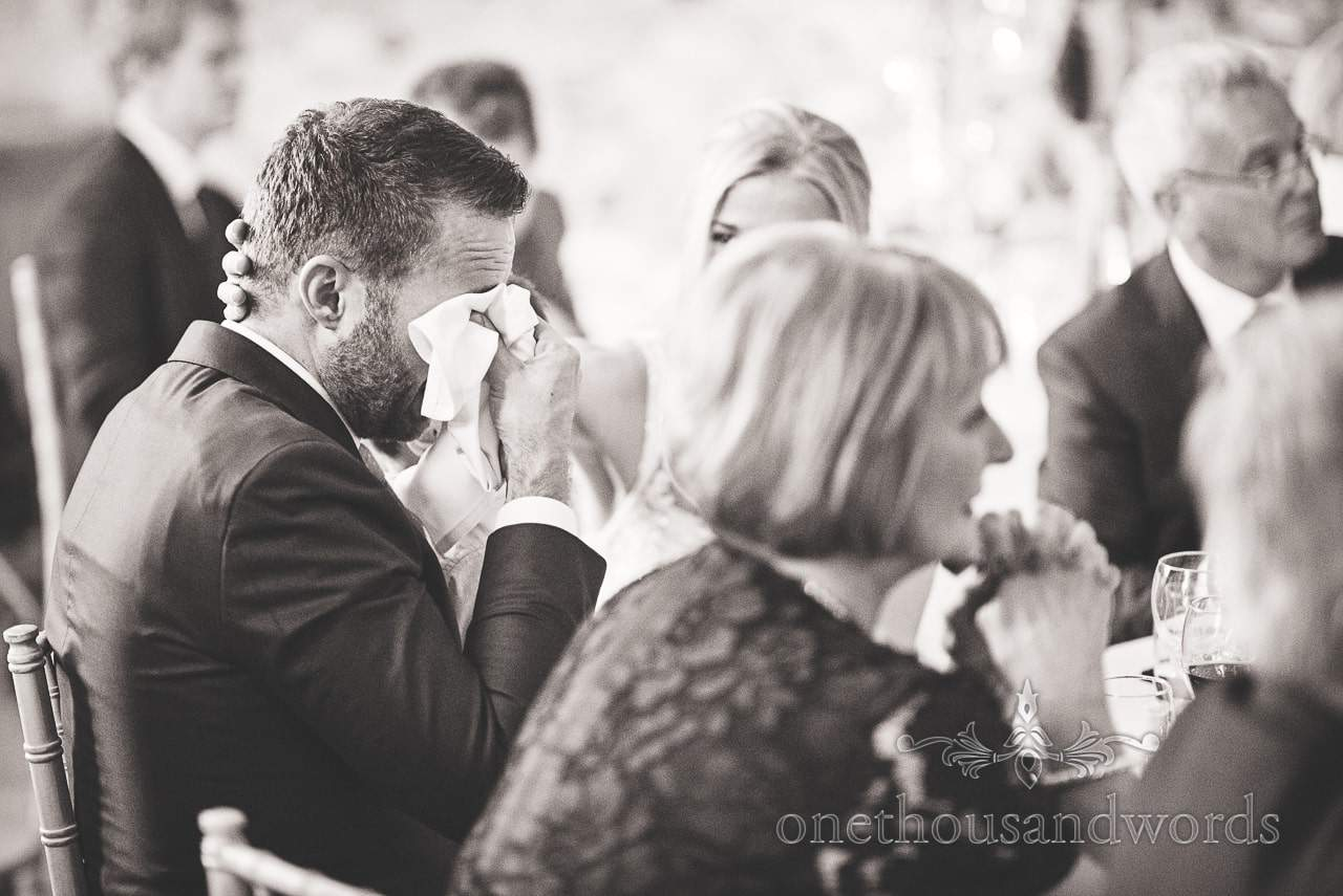 Groom crying during wedding speeches at Lulworth Castle Wedding venue in Dorset