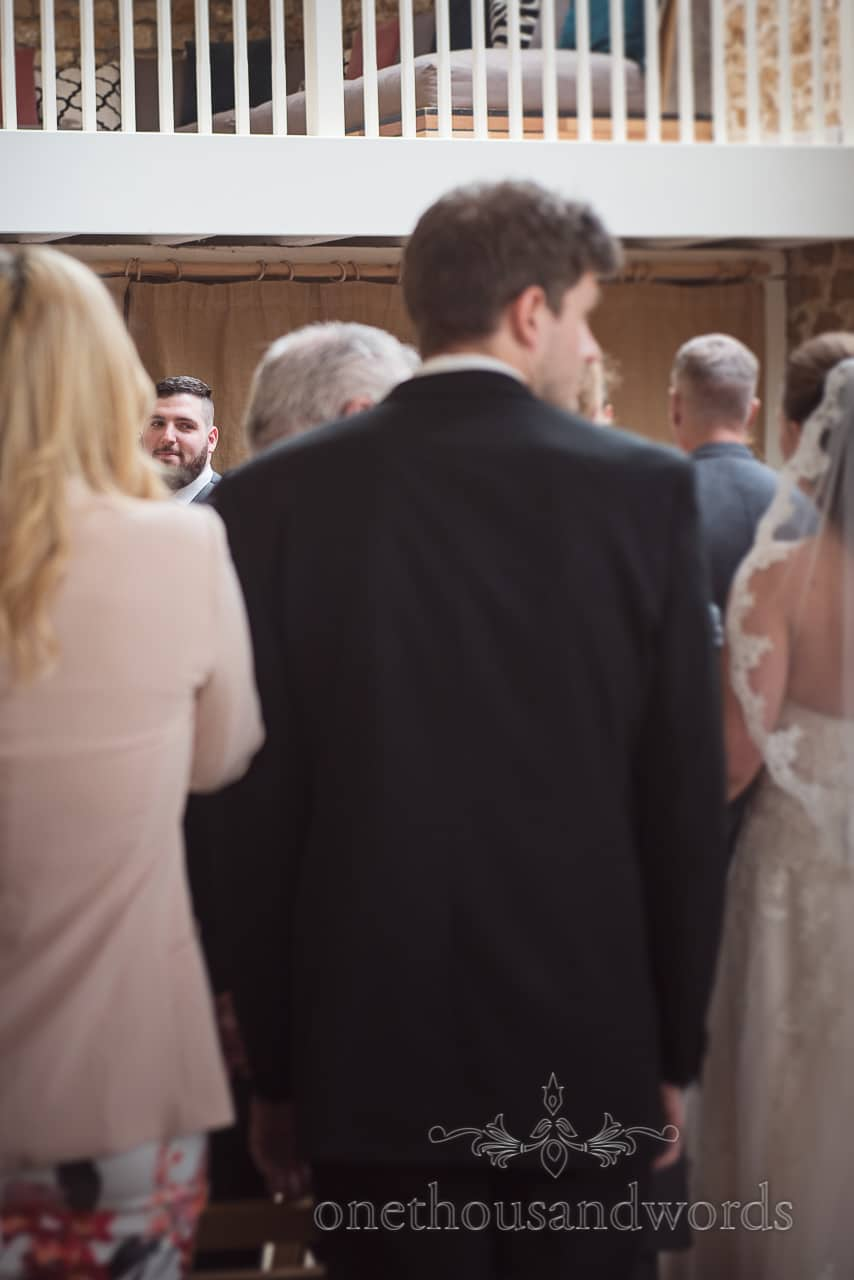 Groom gets his first look at his bride to be at Tithe Barn Symondsbury Wedding