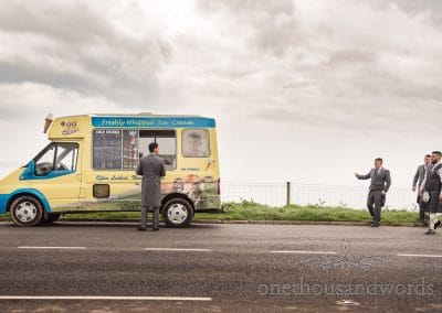 Groomsman buys groom have a ice cream before Tithe Barn Symondsbury Wedding