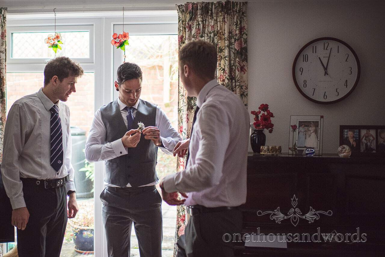 Groomsman with buttonhole from Tithe Barn Symondsbury Wedding