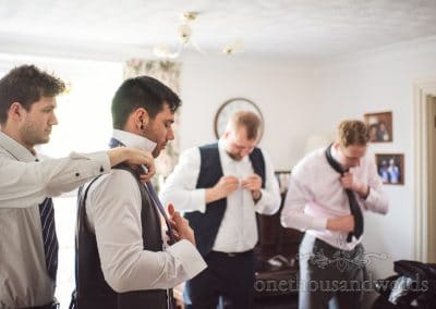 Groomsmen getting ready on morning of Tithe Barn Symondsbury Wedding