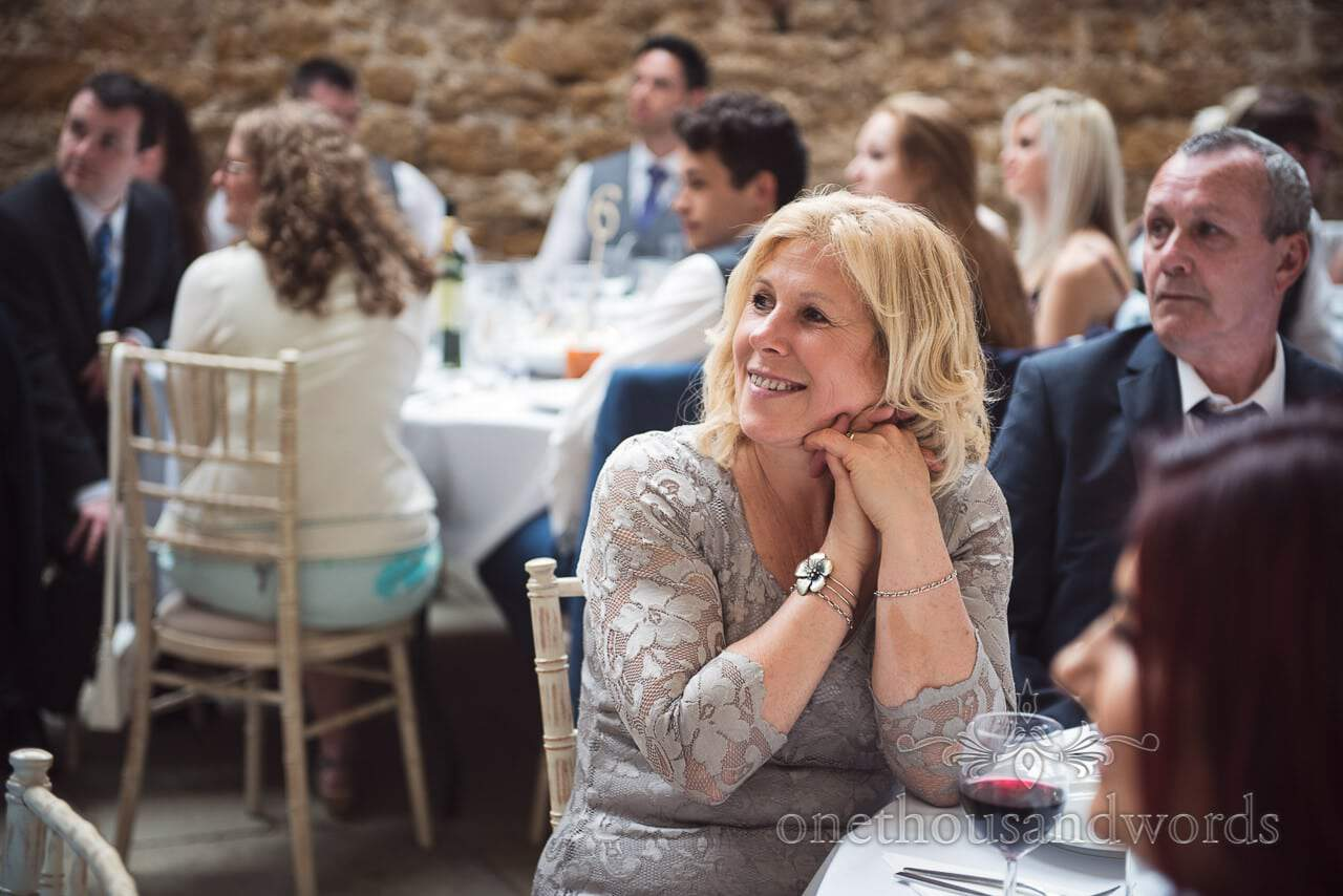 Guest reaction during speeches at Tithe Barn Symondsbury Wedding