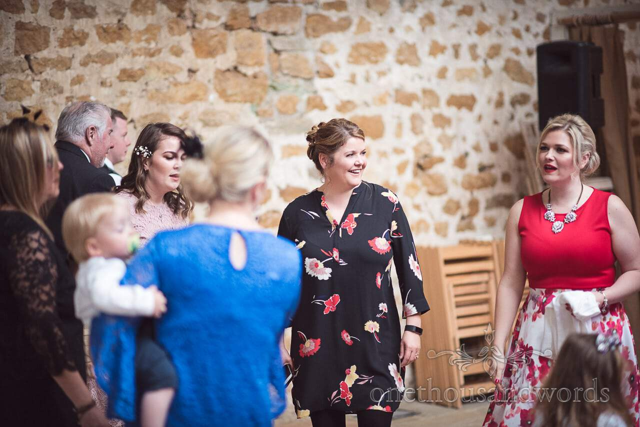Guests dance at evening reception during Tithe Barn Symondsbury Wedding