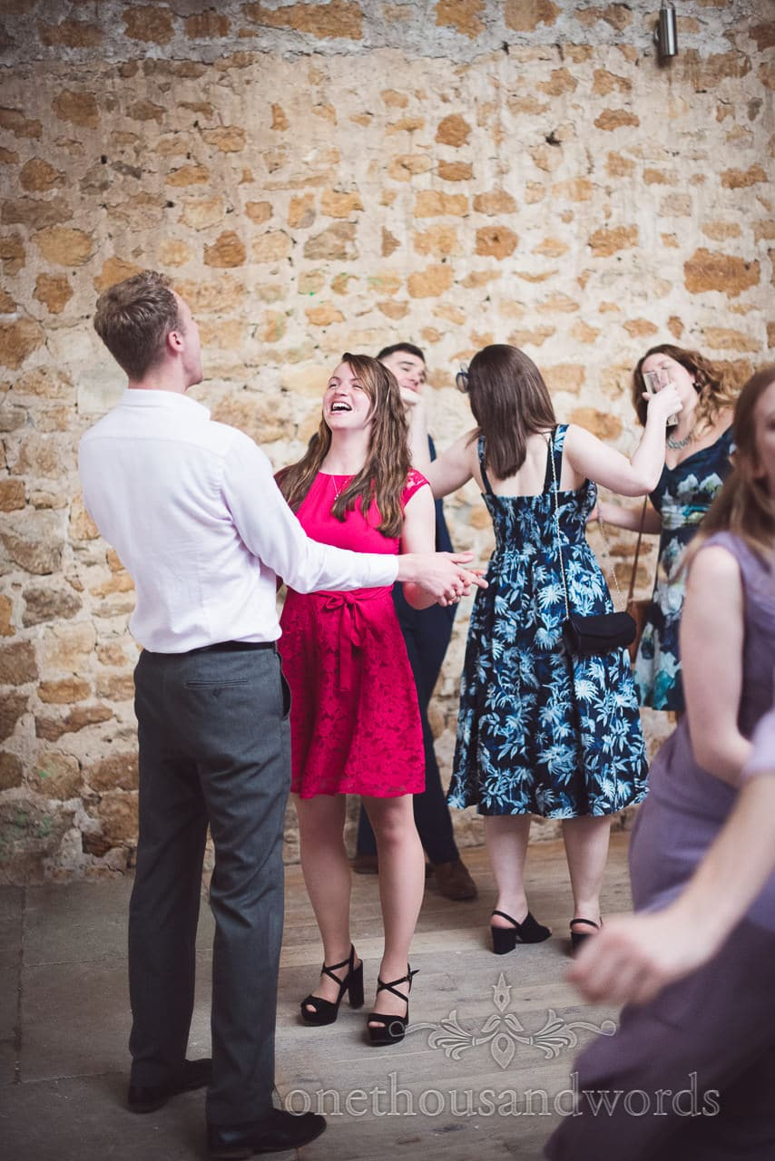 Guests on the dance floor during Tithe Barn Symondsbury Wedding