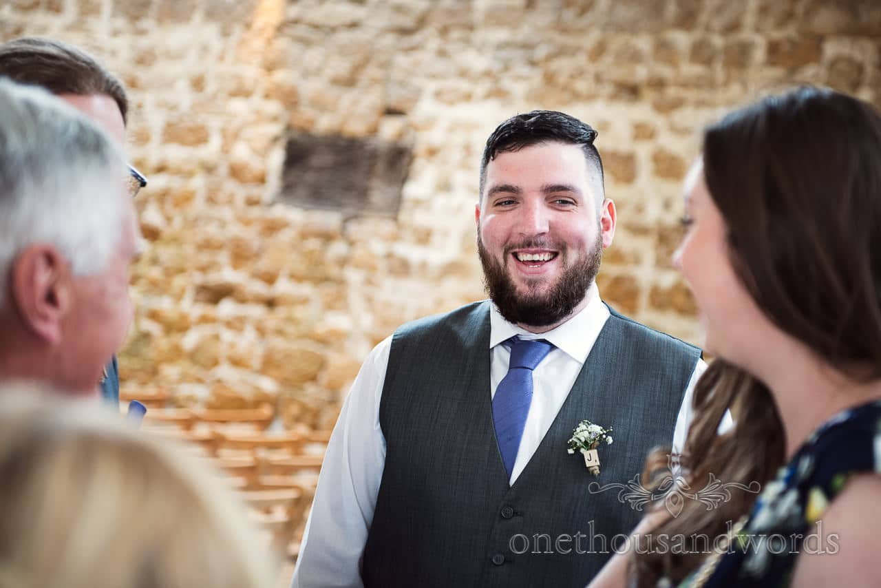 Laughing groom before Tithe Barn Symondsbury Wedding