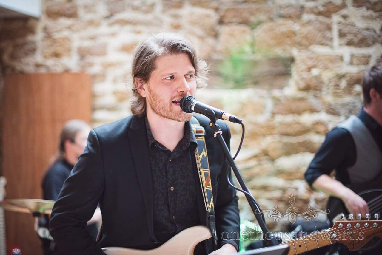 Lead vocalist sings during Tithe Barn Symondsbury Wedding