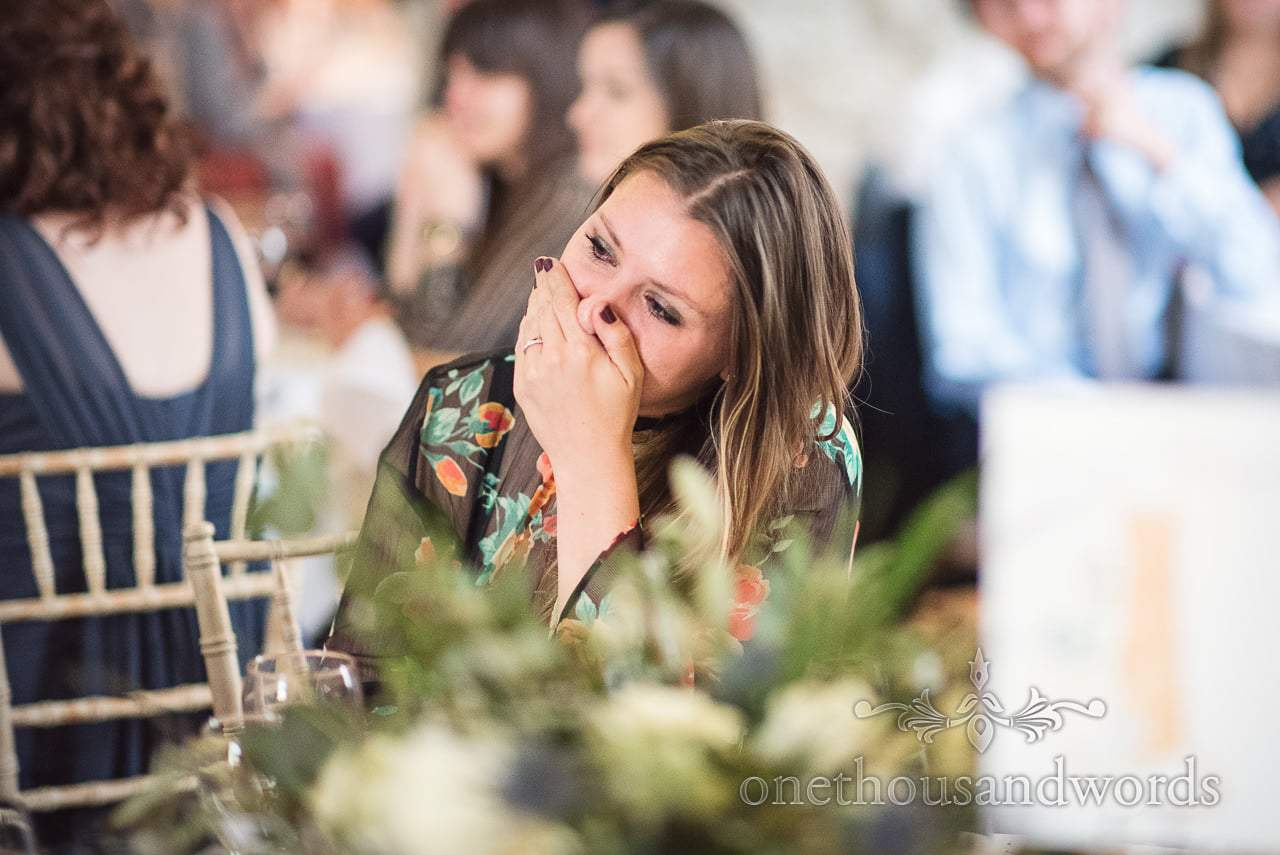 Lulworth Castle Wedding Photo of guest crying during wedding speeches