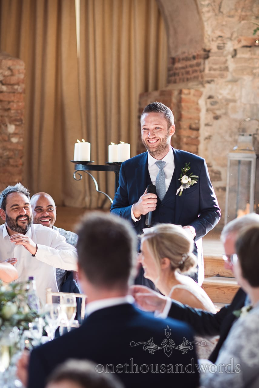 Lulworth Castle Wedding Photograph of groom's wedding speech in Dorset