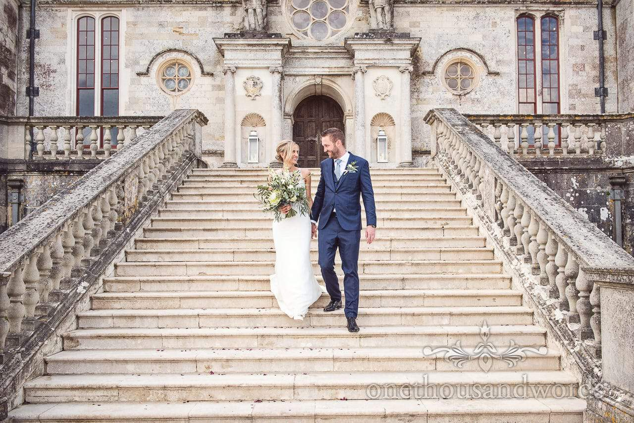 Lulworth Castle Wedding Photos of bride and groom on stone staircase