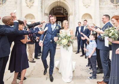 Lulworth Castle Wedding Photos of confetti throwing at Dorset Castle wedding