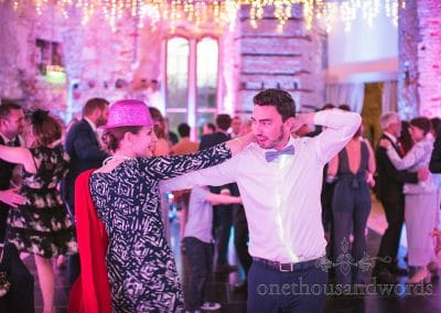 Lulworth Castle Wedding Photos of Wedding guests dancing in fancy dress