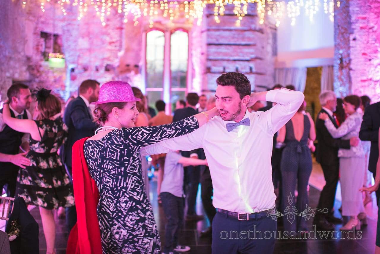 Lulworth Castle Wedding Photos of Wedding guests dancing in fancy dress