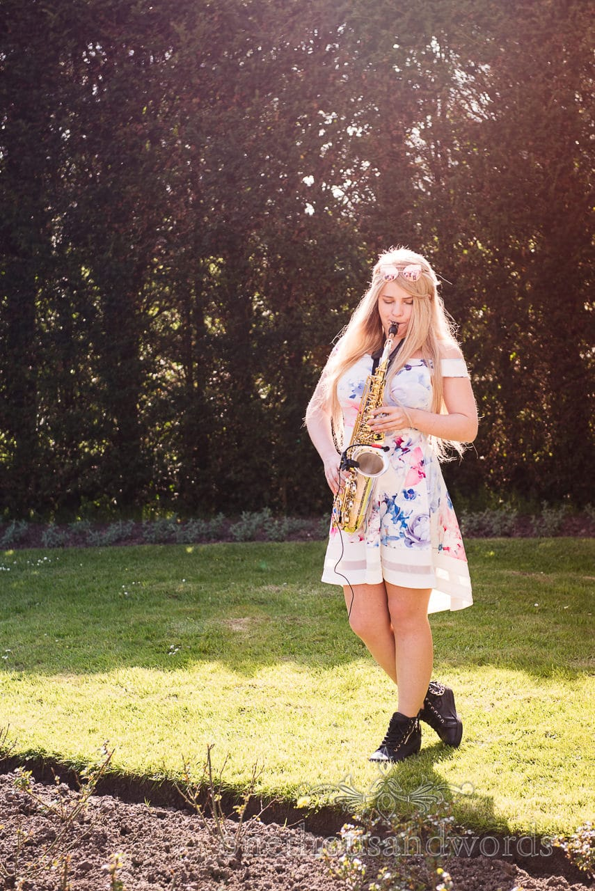 May Crick plays Saxophone at Lulworth Castle Wedding drinks reception