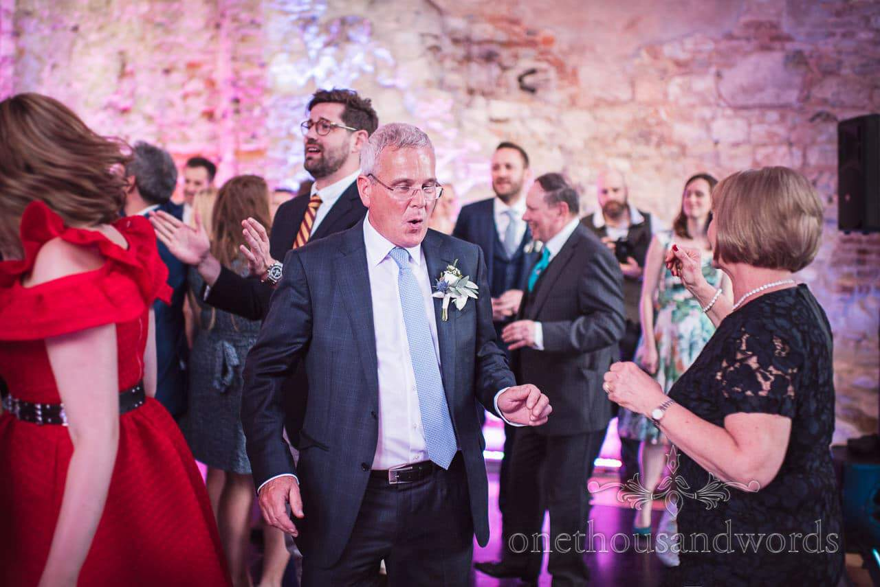 Mother and father of the bride on the dance floor at Lulworth Castle Wedding