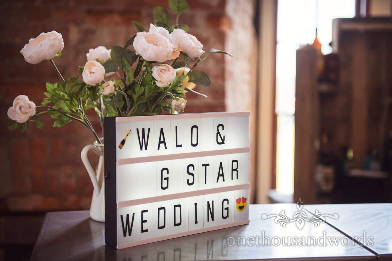 Personalised light-box bar sign from Lulworth Castle Wedding Photos