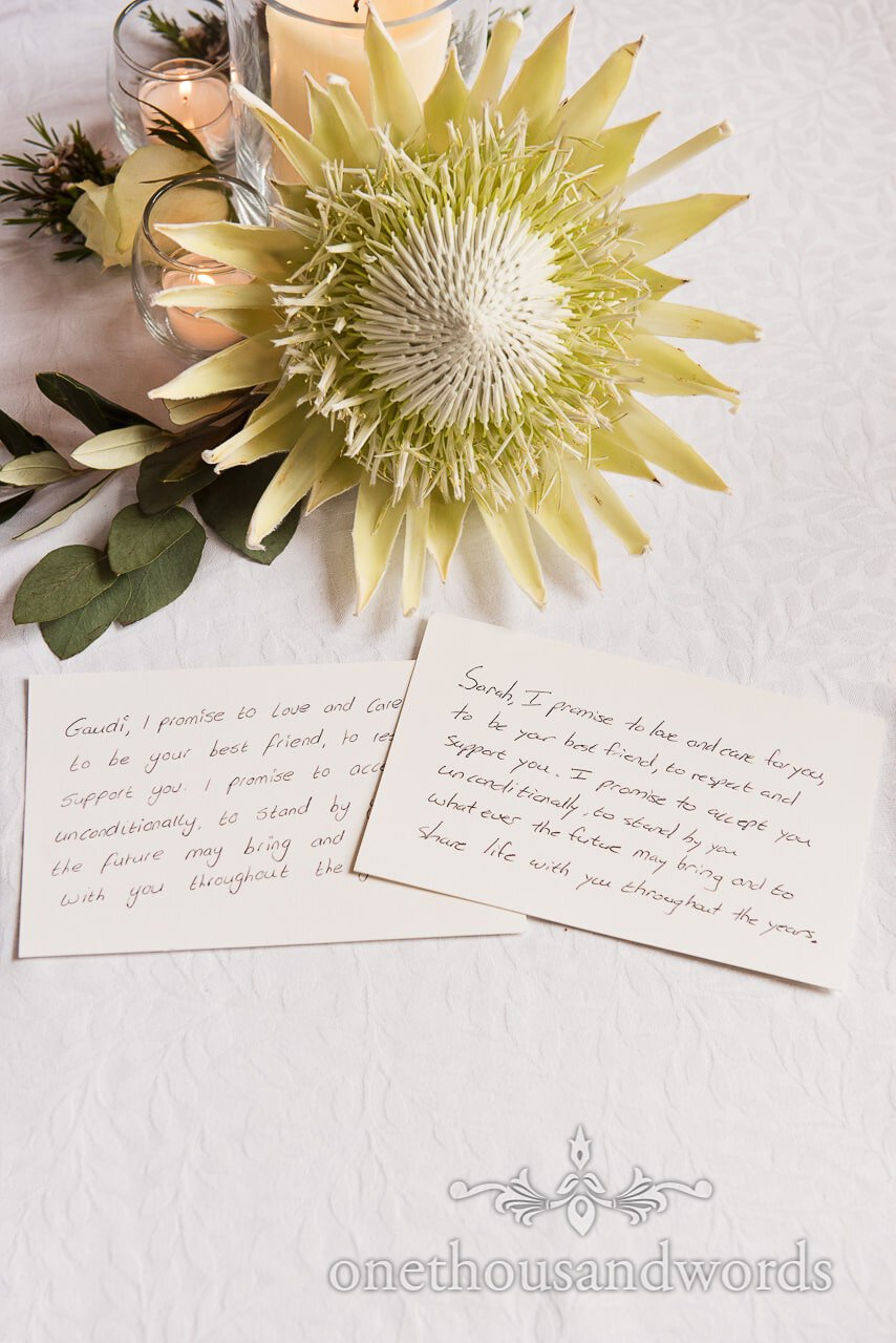 Protea wedding flower with candles and hand written wedding vows photograph