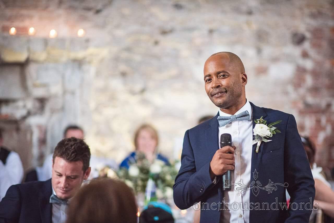 Smiling best man makes best man's speech at Lulworth Castle Wedding venue