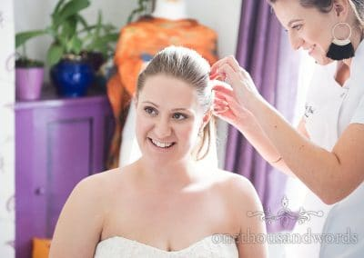 Smiling bride on morning of Tithe Barn Symondsbury Wedding
