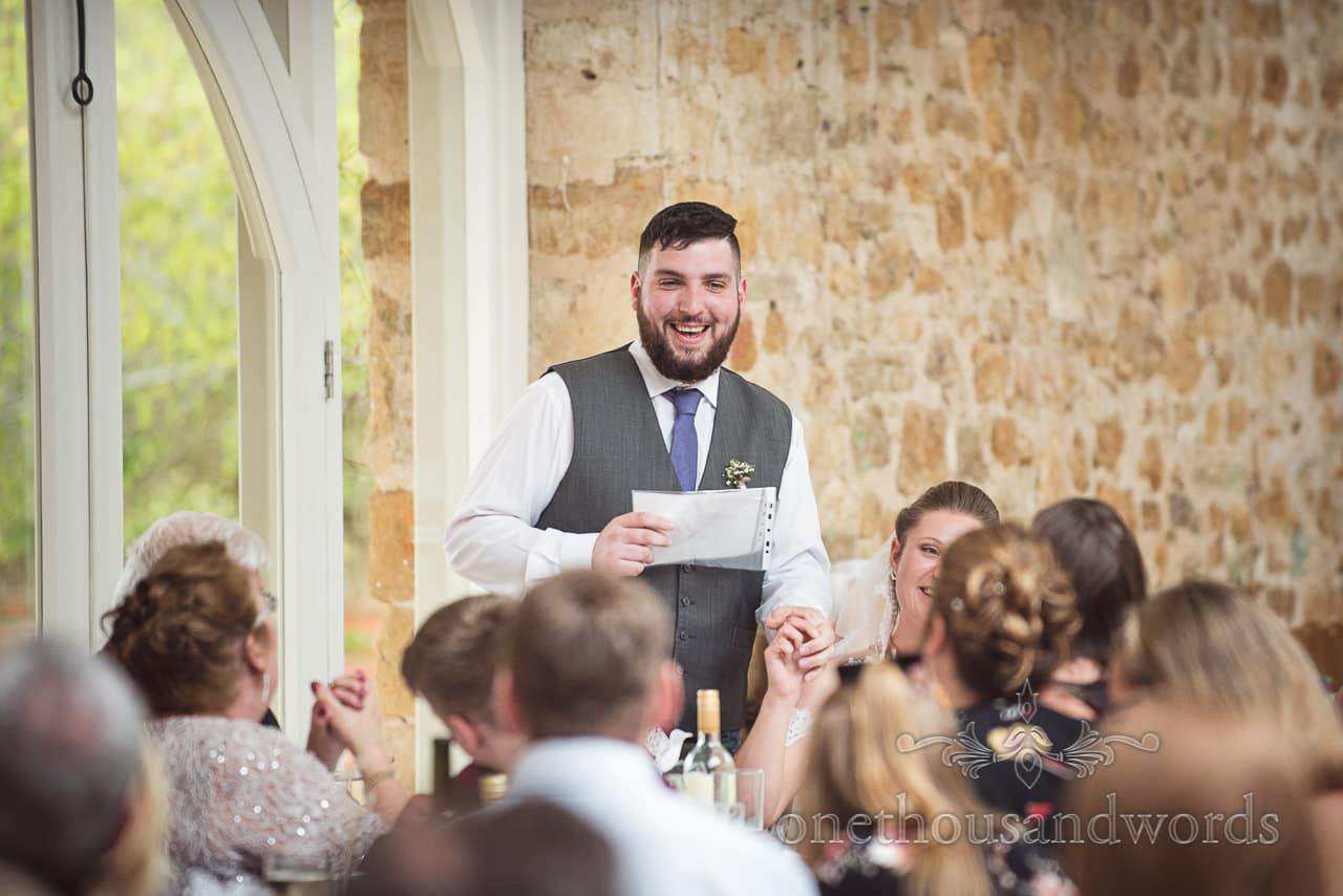 Smiling groom delivers speech at Tithe Barn Symondsbury Wedding